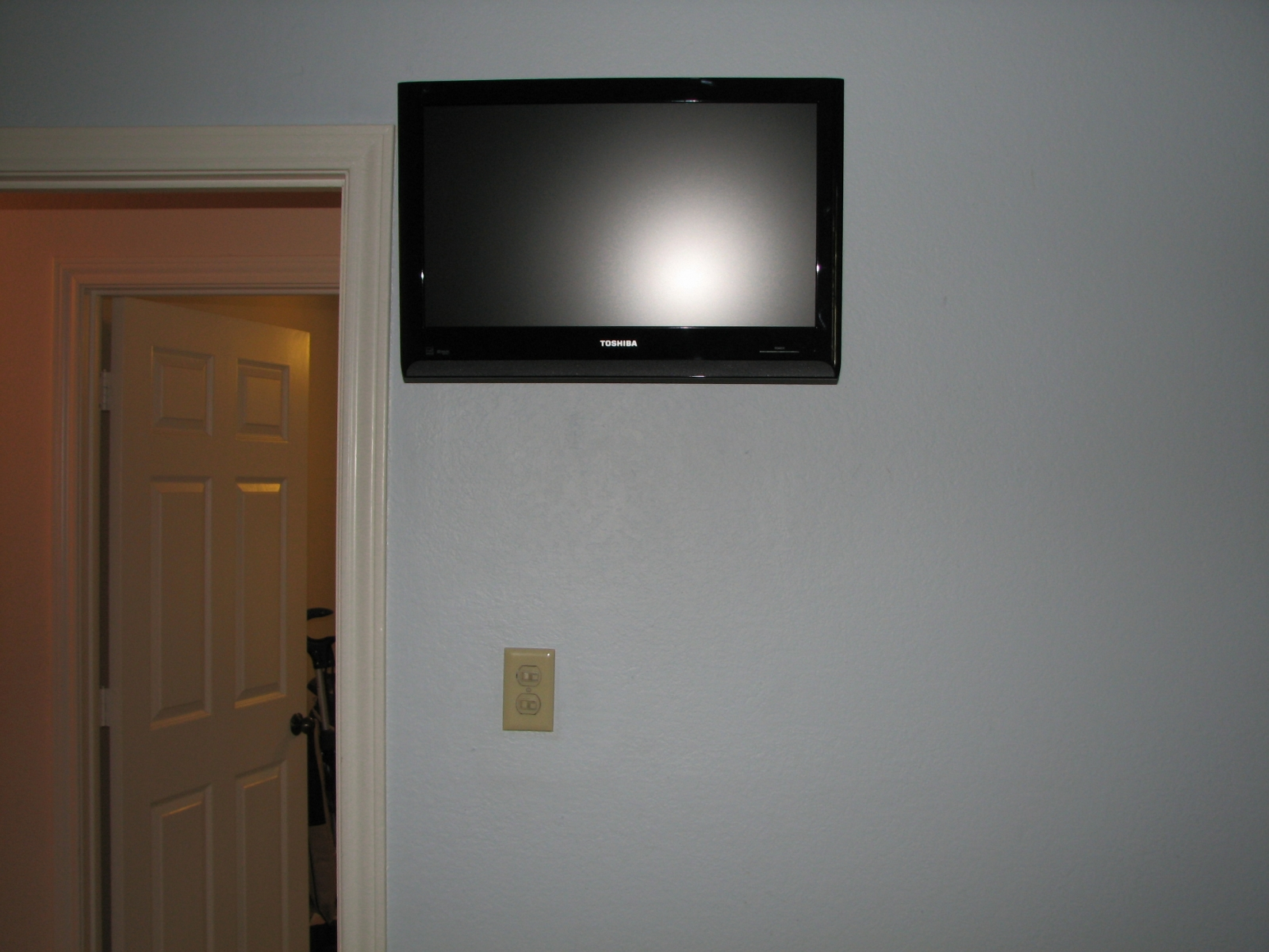 tv mounted on wall in bedroom