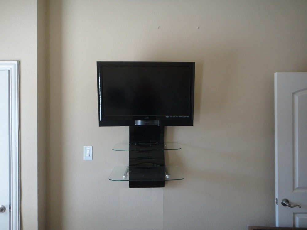 Photo Visio On wall TV installation with shelves Dallas TX