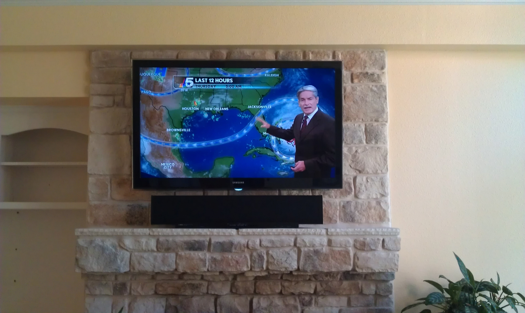 samsung flat screen tv on wall. photo samsung living room tv installed on stone with sound bar irving tx flat screen tv wall