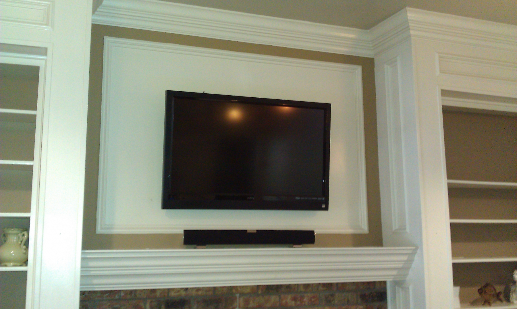 Photo sony tv mounted with sound bar installation dallas tx